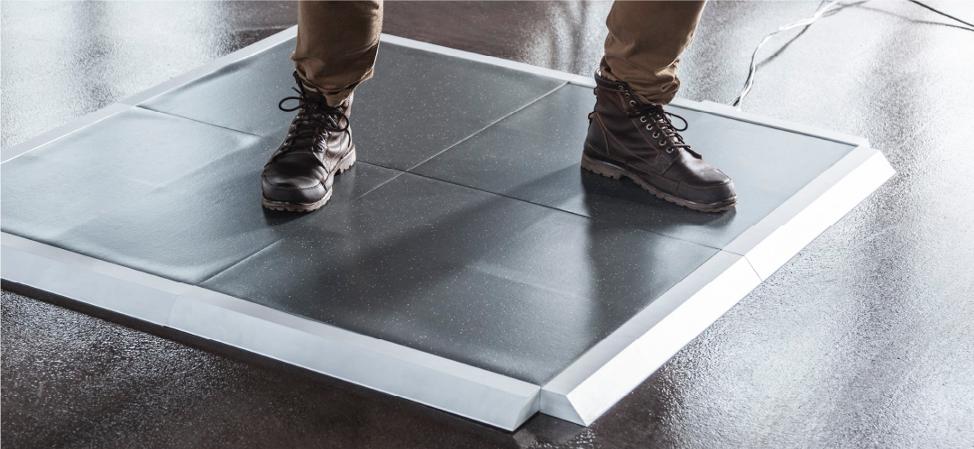 Combat boots on four-tile Stepscan Platform System