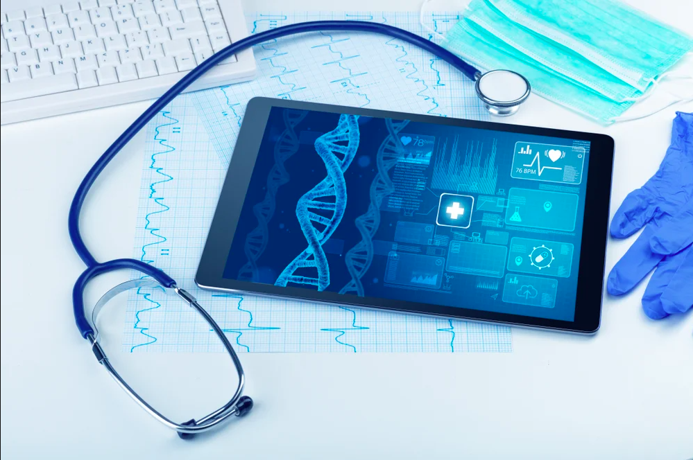 Stethoscope, medical glove, and tablet displaying medical states and DNA