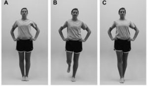 Woman modeling first three hard surface stances of the BESS test